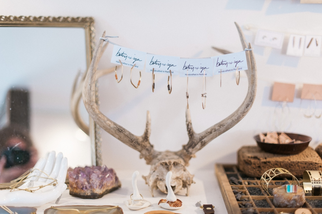 Beautiful jewelry displayed on an old skull and antlers. From Menagerie and photographed by Briana Morrison