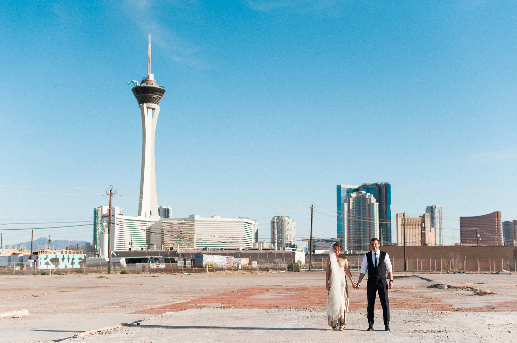 British newlyweds pose in front of the Las Vegas Strip. Captured by Las Vegas Elopement Photographer Briana Morrison