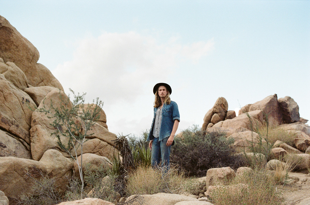 Davey from Bjorn and The Sun standing on the rocks in Joshua Tree National Park. Photographed by Joshua Tree wedding photographer, Briana Morrison