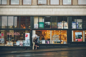 Danielle & Scot in front of Jackpot Records during their Portland Engagement Session - Photograph by Briana Morrison