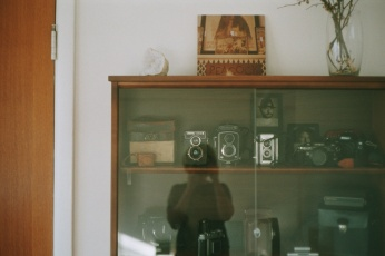 A film self portrait and my camera collection - by Briana Morrison