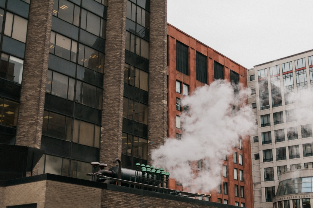 Steam rising from the Leonard N. Stern School of Business in Manhattan - Photography by Briana Morrison