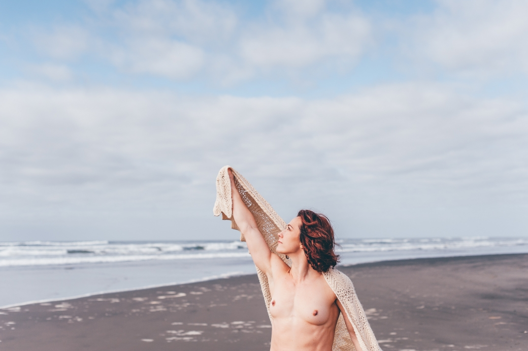 Nude woman on the beach with a blanket. Boudoir Photography by Briana Morrison