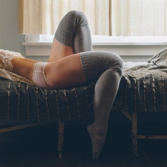 Sexy legs and thigh high socks photographed by Portland boudoir photographer Briana Morrison