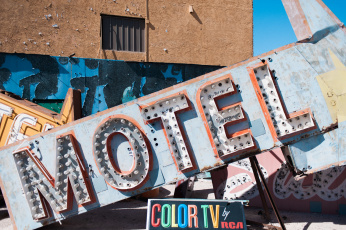 Illustrating my Netflix watch list, a photograph of retro motel and color TV by RCA signs from the Neon Boneyard in Las Vegas, Nevada. Photography by Briana Morrison