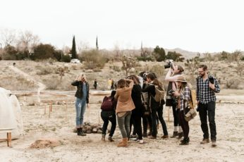 A group of photographers shooting a model. A review of Heck Yeah Photo Camp 2016 by Briana Morrison