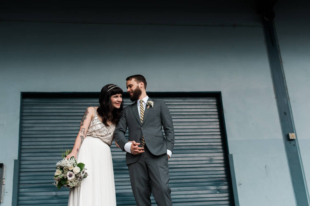 A hip bride and groom get married at Holocene in Portland, Oregon. Photography by Portland wedding photographer Briana Morrison