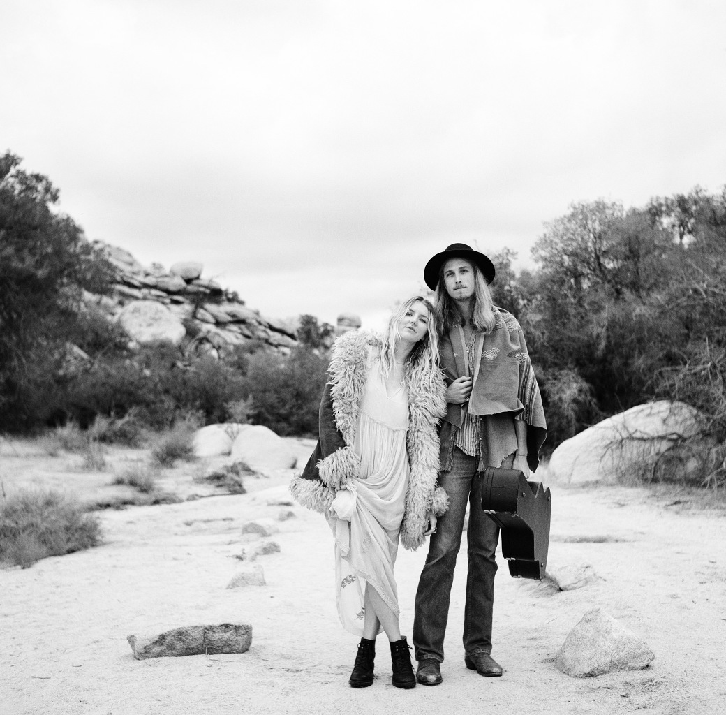 A black and white film photographer of Bjorn and The Sun musicians, Amanda and Davey in Joshua Tree, California. Photographed by Joshua Tree wedding photographer, Briana Morrison