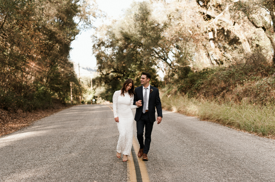 Bride and groom walk together on their wedding day. By Chico Wedding Photographer Briana Morrison