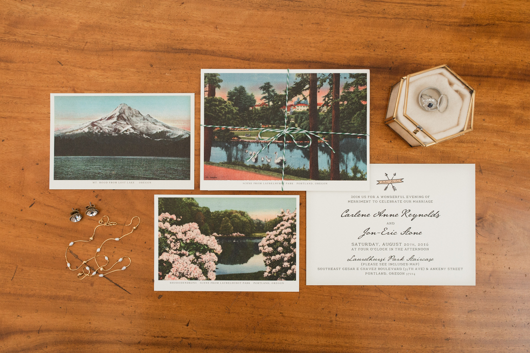Beautiful custom wedding invitation and jewelry. By Laurelhurst Park wedding photographer Briana Morrison