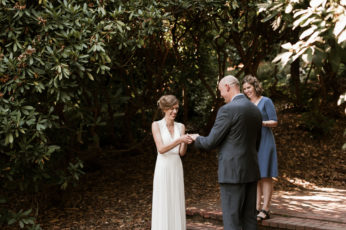 The bride puts a ring on it. By Laurelhurst Park wedding photographer Briana Morrison