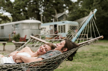 A bride and groom lounge in a hammock at Sou'Wester before their ceremony. By Long Beach Washington wedding photographer Briana Morrison